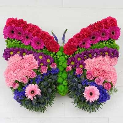 Kelebek renkleri model/Karanfil cerbera gül kırçiçekleri ve özel ithal çiçekler ile hazırlanmış özel tasarım aranjman