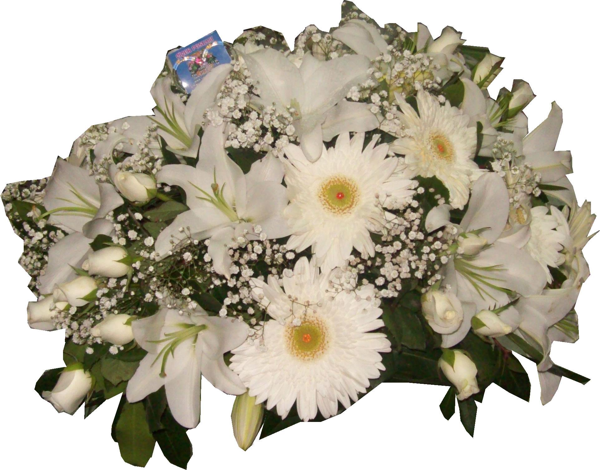 Beyaz lilyumlar ve güllerle hazırlanmış masa aranjmanı